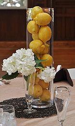 lemons in a vade nonfloral centerpiece